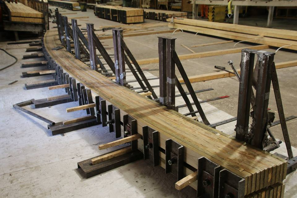 Glulam beam being pressed